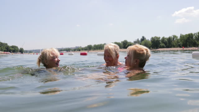 female seniors swimming, handheld shot - sporting term stock videos & royalty-free footage