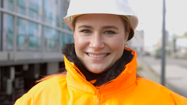 female shipping engineer in protective workwear - clothing stock videos & royalty-free footage