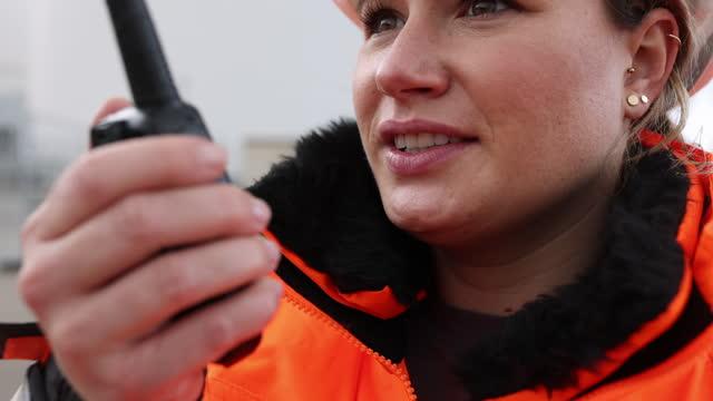 female shipping engineer talking on walkie talkie - clothing stock videos & royalty-free footage