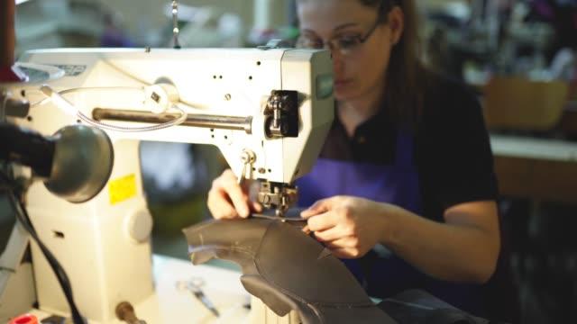 female shoemaker using sewing machine - animal skin stock videos & royalty-free footage