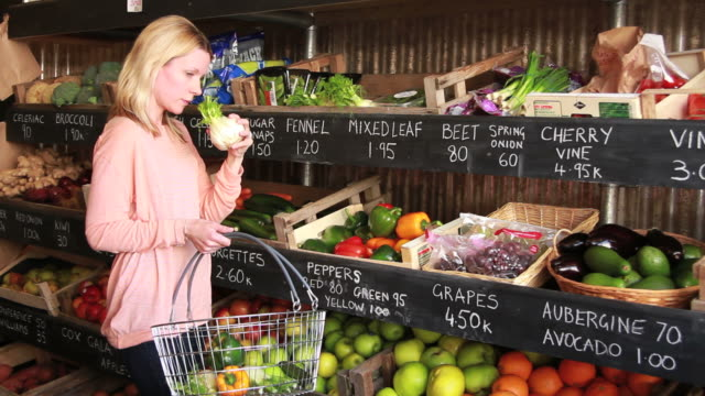 female shopping grocery in organic shop - blonde hair stock videos & royalty-free footage