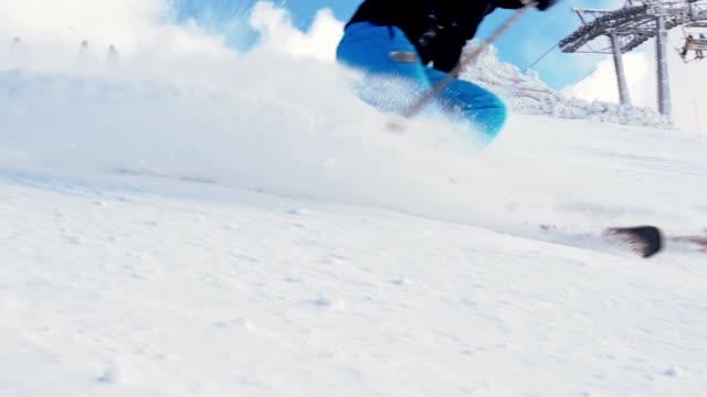 SLO MO Female skier spraying snow at camera
