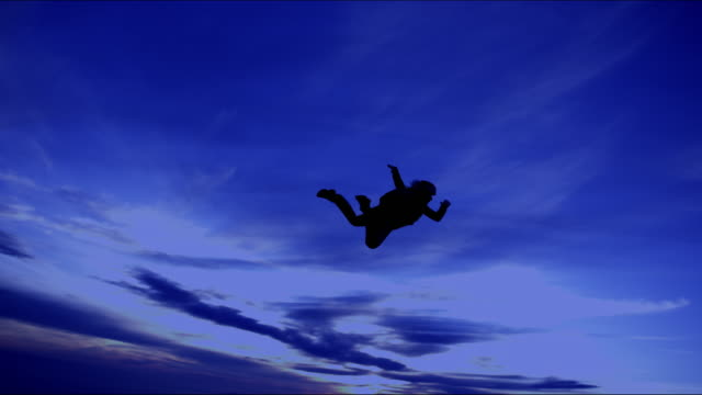 female skydiver at dusk - free falling stock videos & royalty-free footage
