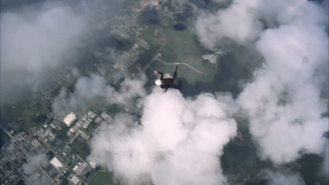 female skydiver falls past camera - airplane part stock videos and b-roll footage