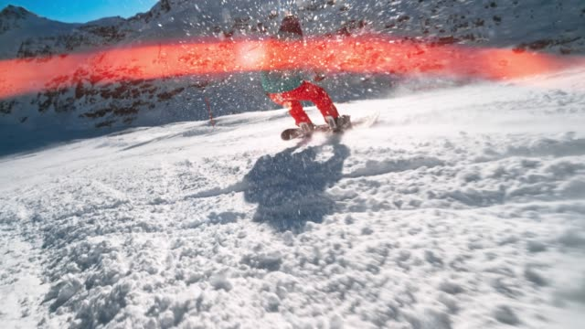 speed ramp ts female snowboarder descending the snow covered mountain in sunshine with flares - sports equipment stock videos & royalty-free footage