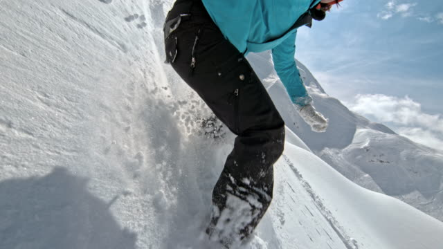 slo mo female snowboarder riding in powder snow - snowboarding stock videos & royalty-free footage