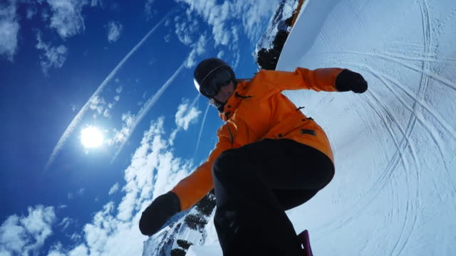 pov female snowboarder riding in the half-pipe on a sunny day - jacket stock videos and b-roll footage