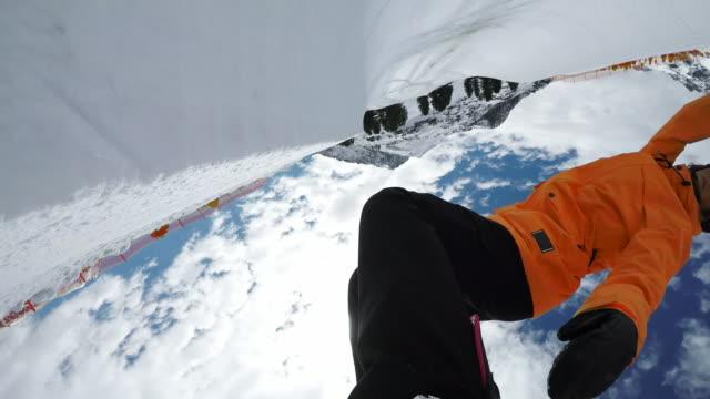 POV Female snowboarder riding the half-pipe