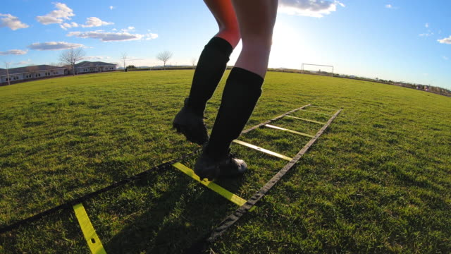 female soccer player doing footwork drills - ladder stock videos & royalty-free footage