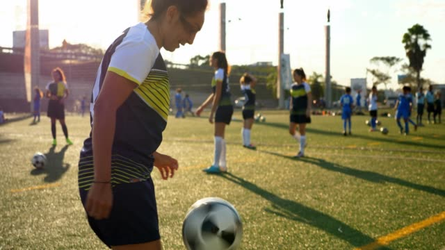 ms female soccer player warming up with teammates on field before game - authority stock videos & royalty-free footage