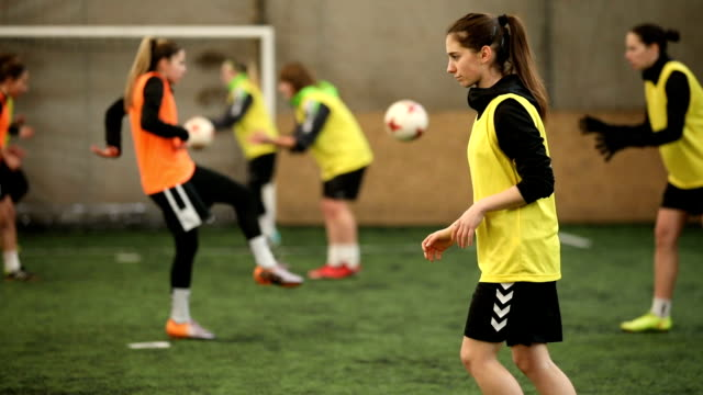 female soccer players passing the ball - indoor soccer stock videos & royalty-free footage