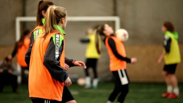 female soccer players passing the ball - football strip stock videos & royalty-free footage