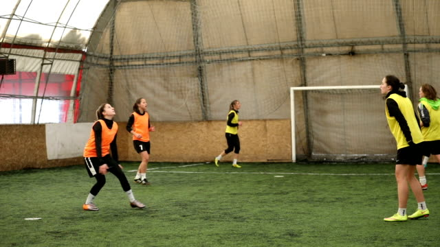female soccer players practice head kick - indoor soccer stock videos & royalty-free footage