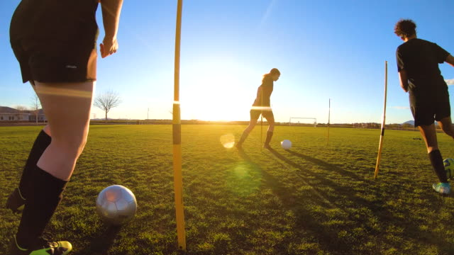 female soccer players practicing ball skills - practising stock videos & royalty-free footage