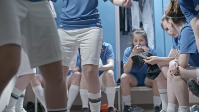 female soccer players spending time in locker room before practice - women's football stock videos & royalty-free footage