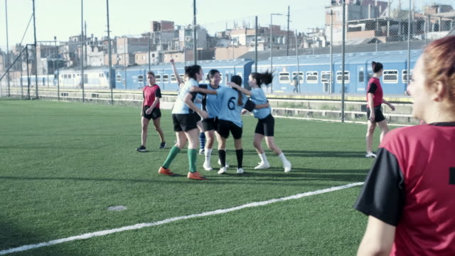female soccer team celebrate a goal at the field - team sport stock videos & royalty-free footage