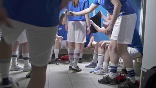 female soccer team getting ready in locker room - medium group of people stock videos & royalty-free footage