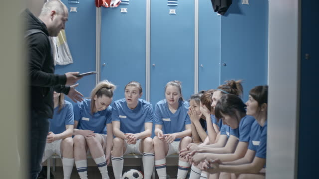 female soccer team hearing bad news from male coach - football team stock videos & royalty-free footage