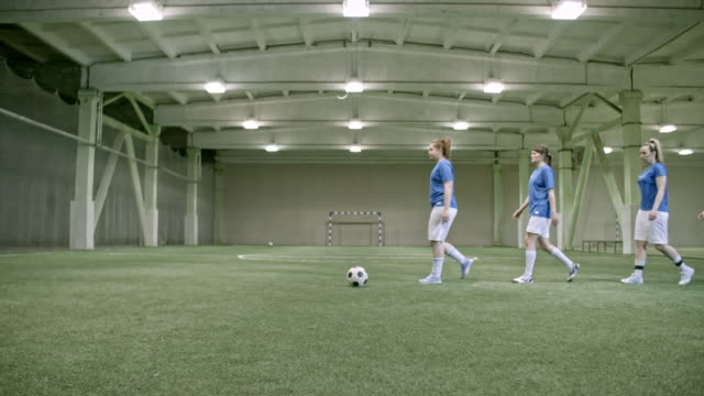 female soccer team lining up in indoor field - women's football stock videos & royalty-free footage