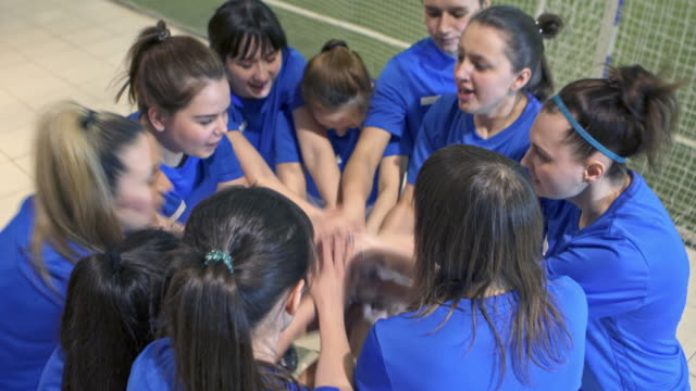 female soccer team motivating each other before game - football team stock videos & royalty-free footage