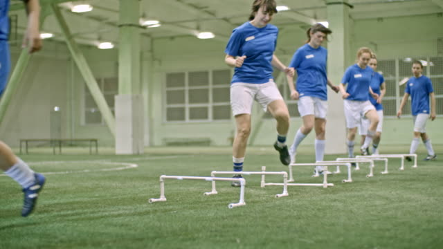 female soccer team players sidestepping over hurdles - 20 29 years stock videos & royalty-free footage