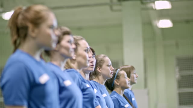 female soccer team standing in line - rack focus stock videos & royalty-free footage