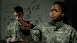 Female Soldier explaining plan of action