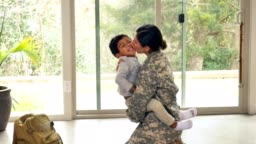 Female soldier greets on upon her return home from active duty
