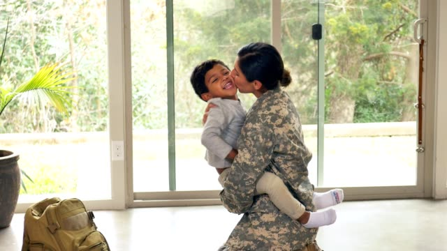 female soldier greets on upon her return home from active duty - homecoming stock videos & royalty-free footage