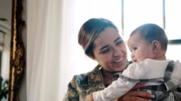 Female soldier is reunited with her baby daughter