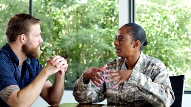 female soldier meets with a male counselor - military recruit stock videos & royalty-free footage