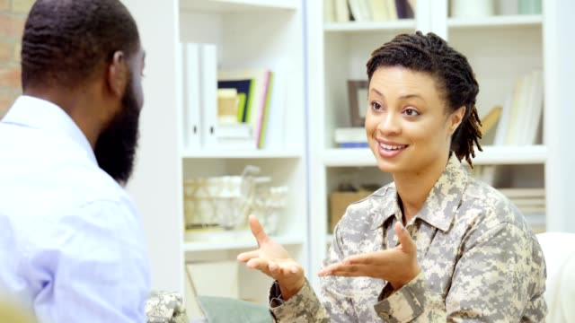 female soldier smiles while talking with a counselor - mental health professional stock videos & royalty-free footage