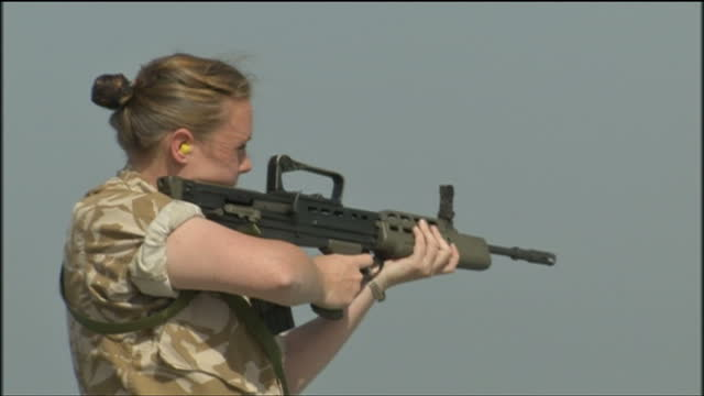 female soldiers can expect to fight alongside men on the front line as david cameron vows to finish the job of overhauling the army but the move... - gender stereotypes stock videos & royalty-free footage