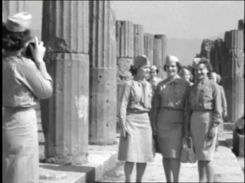 female soldiers take pictures around roman pillars / rome italy - 1944 stock videos and b-roll footage