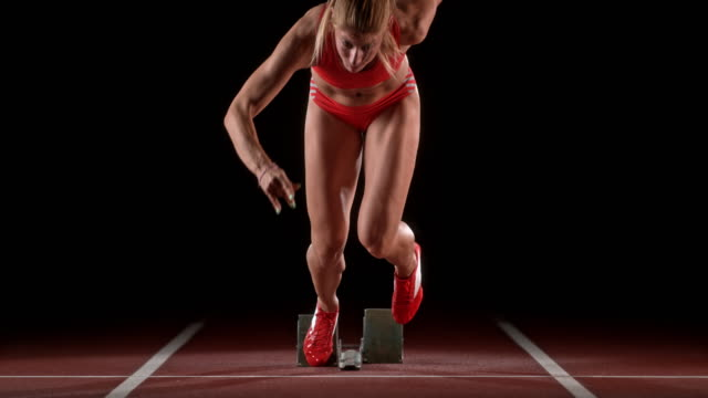 slo mo ld female sprinter starting - front view stock videos & royalty-free footage