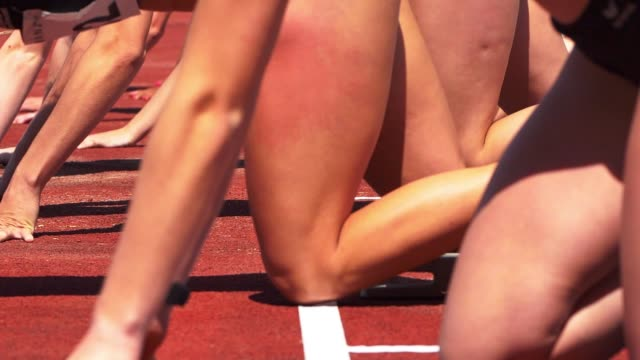 female sprinters preparing for start - anticipation stock videos & royalty-free footage