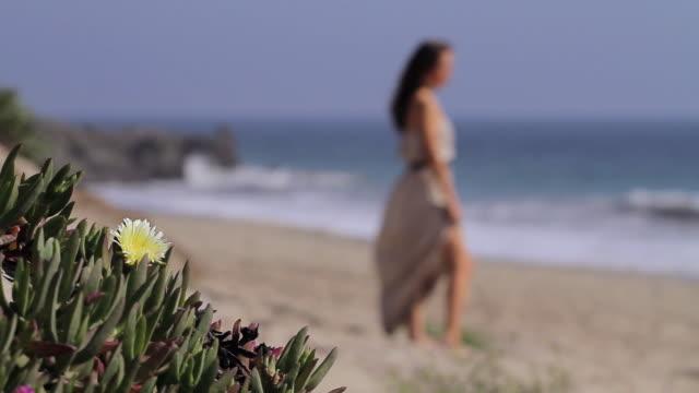 Female standing on beach