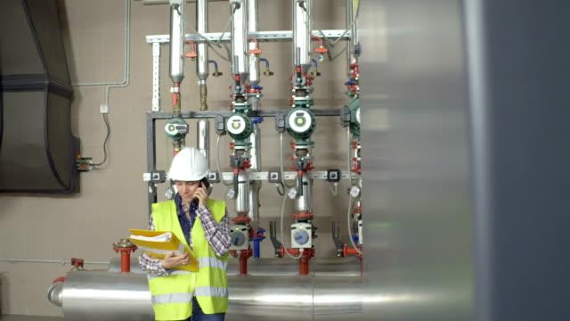female stationary engeneer at work - boiler stock videos & royalty-free footage