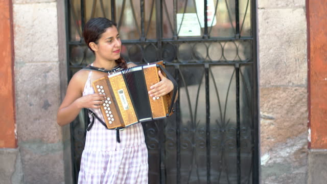 female street musician plays accordion, ms - street performer stock videos & royalty-free footage