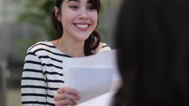 Female student celebrating exam result