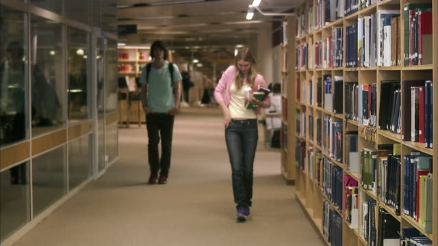 female student dropping her books and getting help from a male student, sweden. - sideways glance stock videos and b-roll footage