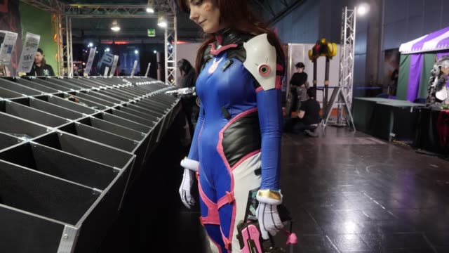 """female student from vienna poses in a costume of the cosplay character """"dva"""" from the game """"overwatch"""" during a lan party in the expo area at the... - cyberspace stock videos & royalty-free footage"""