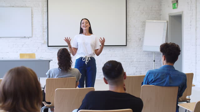female student giving presentation in classroom - three quarter length stock videos & royalty-free footage