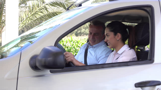 female student learning how to drive - instructor stock videos & royalty-free footage