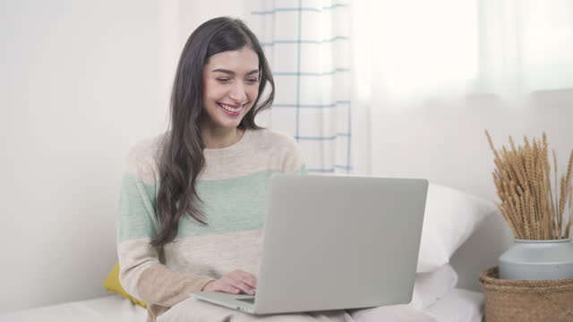 female student sitting on floor of her apartment with laptop and notes studying - hot desking stock videos & royalty-free footage
