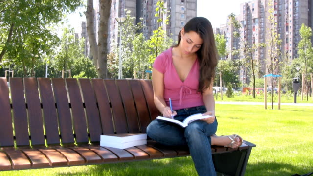 female student - cross legged stock videos and b-roll footage