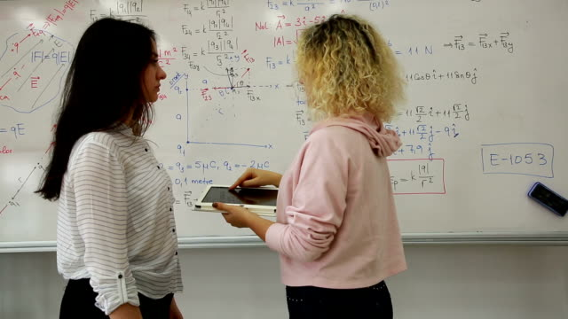 female student writing mathematical formula in front of the whiteboard - mathematician stock videos & royalty-free footage