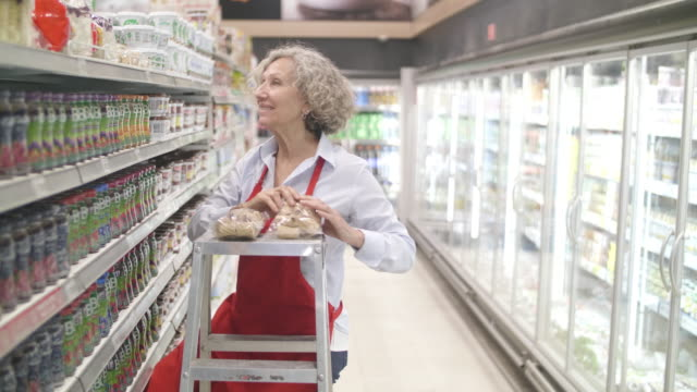 female supermarket worker - employee stock videos & royalty-free footage