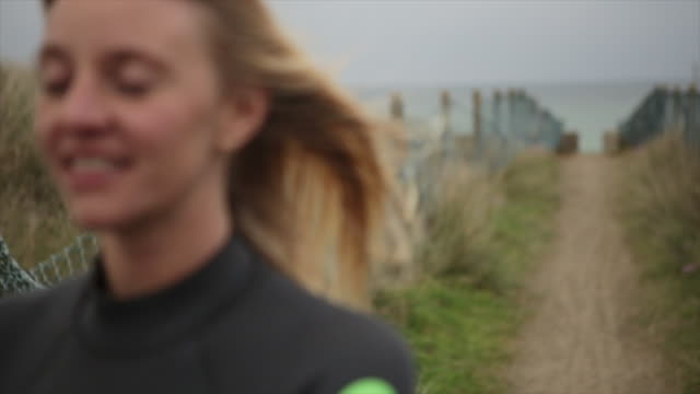 A female surfer's hair blowing in wind