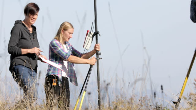 Female Surveyor Using Gps For Accurate Location Stock Footage Video